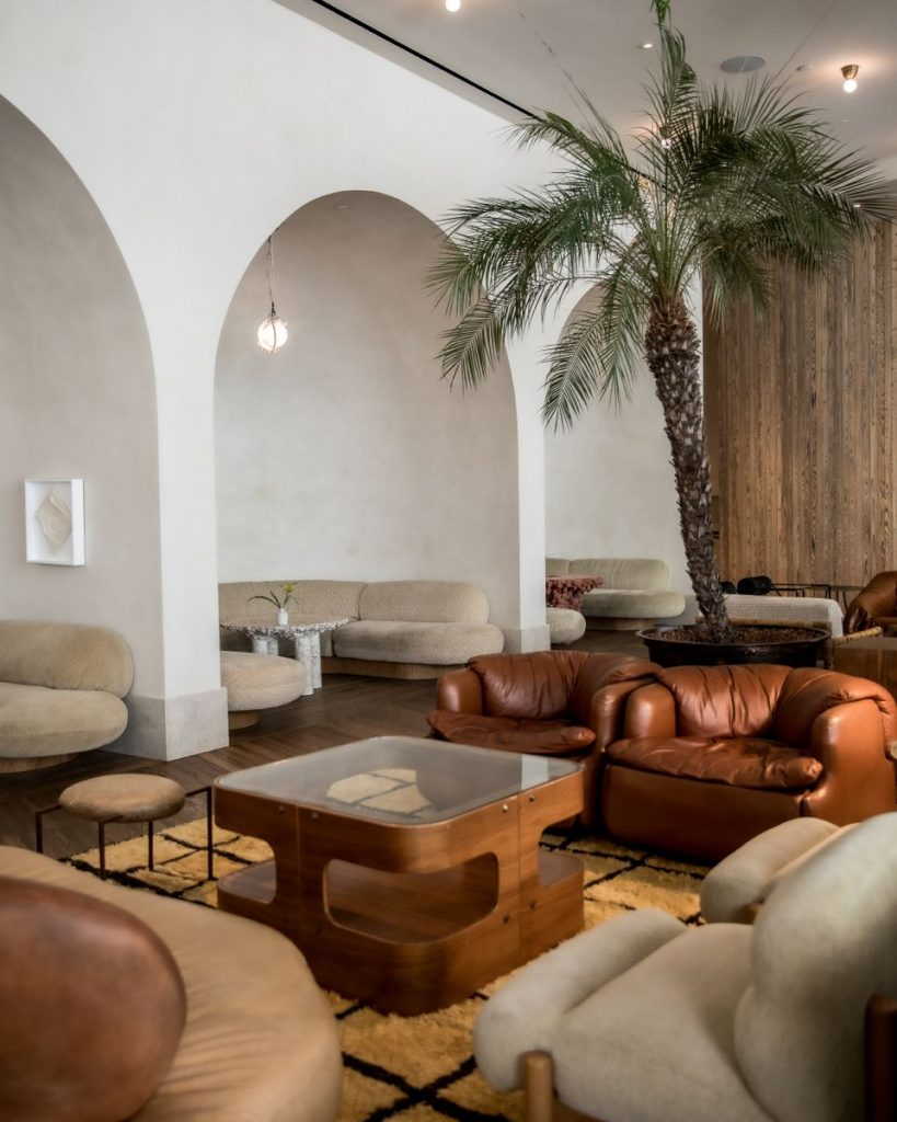 Melanee Shale inspiration hotel lobby living room neutral wood beige brown tones