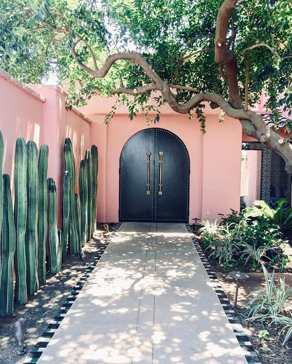 Melanee Shale inspiration pink walls cactus large doors beverly hills vacation