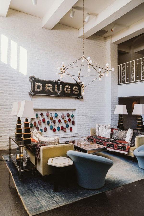 Melanee Shale inspiration drugs wall sign glasses held upside down living room